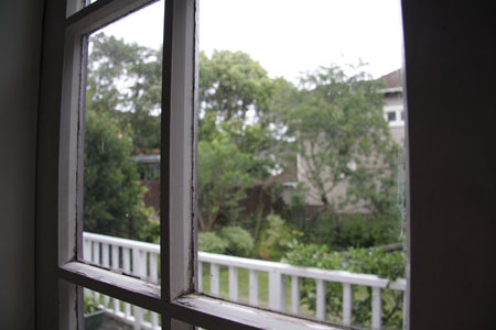 JPG image of a grey backyard from inside a house