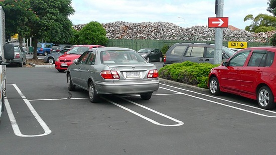 Car parked in four spaces