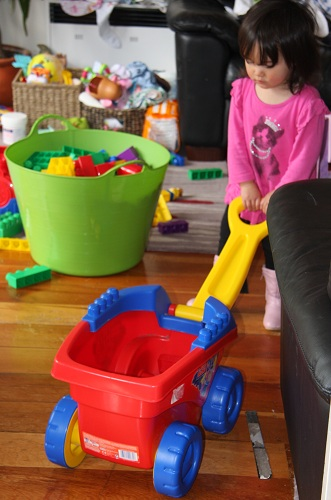 Abby with her newly acquired wagon and tub of blocks