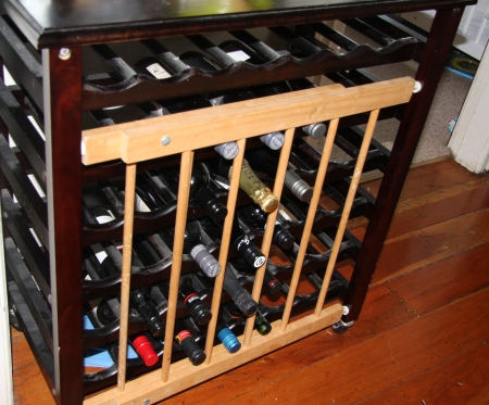 Safety gate on the wine rack