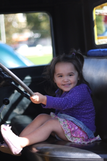 Abby in a Ford V8 truck